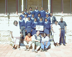 In The CP Nel Museum courtyard- Kolonga J.S.S School and Grant M. Mc Ilrath- A.K.A - The Meerkat Man and pupils, and teachers: Ms. Gigiba, Ms. Ntsabo, Ms. Jaceni, Mr. Seyisana, Mr. Nozewu, Mr. Sinyanza, Mr. Siyeka.