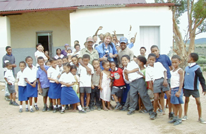 Dale Morris and Marthinus Konstabel and Kiewiet Constable (<b>Research Field Managers for The Meerkat Magic Conservation Project</b>) and school head Mrs.P.V.Jackson and students from Lategansvlei SSKV Primary Farm School in Oudtshoorn, Western Cape in South Africa