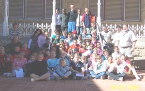 Students and Teachers from Port Alfred High School in the courtyard of The CP Nel Museum in Oudtshoorn in the Western Cape of South Africa.