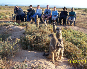 Henry Cole and film crew, who visited The Meerkat Magic Conservation Project in The Meerkat Magic Valley around Oudtshoorn, Western Cape, South Africa, 01 February 2007. Presenter for The Travel Channel - First Class South Africa programme - date of production currently not known.