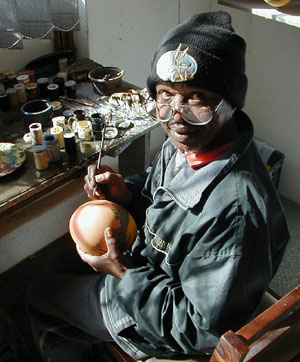 A talented artist painting ostrich eggs.